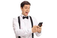 Happy groom using a phone Stock Image