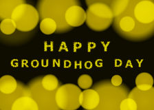 Happy groundhog day. Vector bokeh background. Vector blurry background with bokeh and inscription happy groundhog day Royalty Free Stock Photos