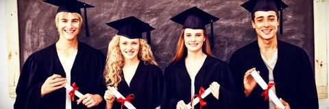 Group of adolescents celebrating after Graduation stock photos