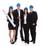 Happy Group Of Architects With Blueprints Royalty Free Stock Images