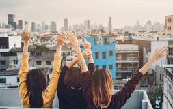 Happy group of asia girl friends enjoy and arm up relax pose at. Roof top party at evening sunset,Holiday celebration festive,teenage lifestyle,freedom and fun Royalty Free Stock Photos
