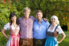 Happy group of bavarian people Stock Photo
