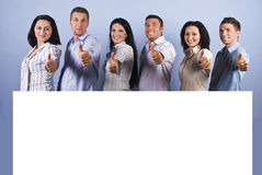 Happy group with blank banner and thumbs up Royalty Free Stock Photos