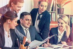 Happy group business people in office. Stock Image