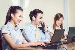 Happy group of businesspeople working in the office stock photo