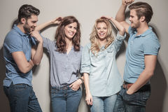 Happy group of casual fashion people laughing. Happy group of young casual fashion people laughing together royalty free stock image