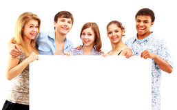 Happy group of casual friends holding Royalty Free Stock Image