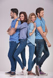 Happy group of casual people, men looking to sides Royalty Free Stock Images
