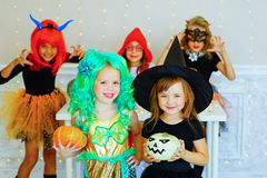 Happy group of children in costumes during Halloween party Stock Photography