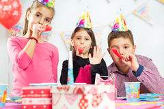 Happy group of children having fun at birthday party Stock Images