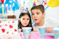 Happy group of children having fun at birthday party stock photo