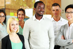Happy group of co-workers standing Royalty Free Stock Image