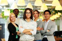 Happy group of co-workers. Standing in office royalty free stock images