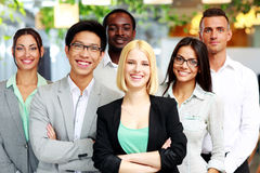 Happy group of co-workers. Standing in office royalty free stock photography