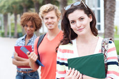 Happy group of college students. Happy group of students holding notebooks outdoors Stock Image