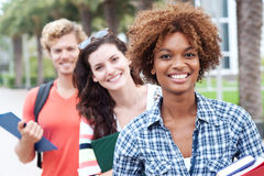 Happy group of college students. Happy group of students holding notebooks outdoors Stock Photos