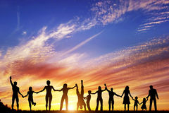 Happy group of diverse people, friends, family together. Happy group of diverse people, friends, family, team standing together holding hands and celebrating Stock Images