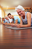 Happy group doing Pilates Stock Photos