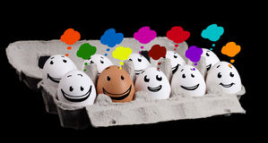 Happy group of eggs with smiling faces representing a social net Royalty Free Stock Photography