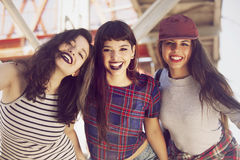 Happy group of female friends having fun. In the city Stock Images