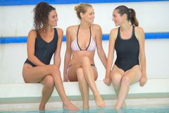 Happy group female friends having fun in swimming pool. Happy group of female friends having fun in swimming pool royalty free stock photos