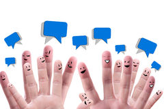 Happy group of finger faces. Social network concept of Happy group of finger faces  with speech bubbles Royalty Free Stock Photography