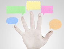 Happy group of finger smileys on male hand. Happy group of finger smileys with social chat sign and speech thought. Fingers representing a social network Royalty Free Stock Photos