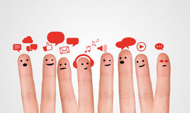 Happy group of finger smileys with social chat sign and speech b Stock Image
