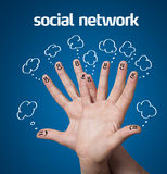 Happy group of finger smileys with social network sign and icons Stock Photography