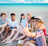 Happy group of friend makes a selfie with a mobile phone Royalty Free Stock Photos