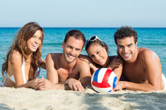 Happy Group Of Friends at Beach Stock Photos