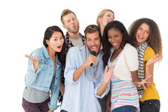 Happy group of friends having fun doing karaoke Royalty Free Stock Image