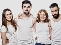 Happy group of friends isolated over white background. Friendship and people concept Royalty Free Stock Images