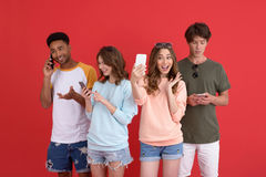 Happy group of friends make selfie using phones. Stock Images