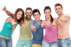 Happy group of friends saying pointing at camera Royalty Free Stock Image