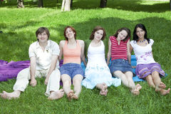 Happy group of friends sitting Stock Photography