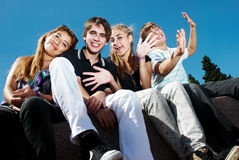 Happy group of friends smiling outdoors Royalty Free Stock Photo