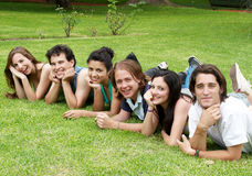 Happy group of friends smiling in a park Stock Photo