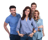Happy group of friends standing together. On white background Royalty Free Stock Images