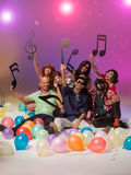 Happy group of friends surrounded with balloons Royalty Free Stock Images
