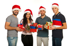 Happy group of friends with Xmas gifts Royalty Free Stock Photo