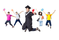 Happy  group in graduate robe jumping together Royalty Free Stock Photo