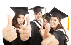 Happy group graduate students thumbs up together Royalty Free Stock Photos
