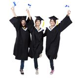 Happy group of graduation girls royalty free stock photography