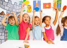 Happy group of kids with cardboard shapes Stock Photo