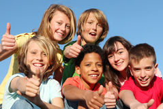 Happy group kids, diversity. Diverse group of kids children teens with thumbs up at summer camp Stock Photo
