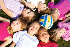 Happy group of kids lying on the floor in a circle Royalty Free Stock Photo
