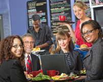 Happy Group with Laptop in Cafe Stock Photography