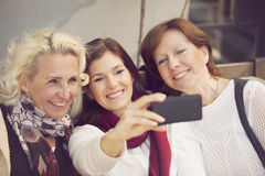 Happy group of mature women having fun. With mobile phone Royalty Free Stock Photography