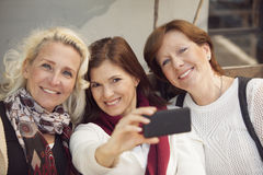 Happy group of mature women having fun. With mobile phone Stock Images